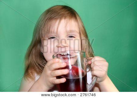 Girl Drinking Cherry Juice