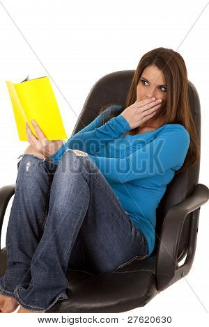 Woman Reading Surprised In Chair