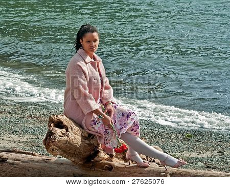 Pretty Multi Ethnic Woman Sad At Beach