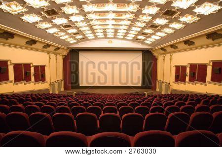 Empty Modern Cinema Auditorium With White Screen