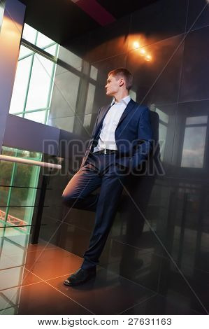 Young Businessman Resting On Wall