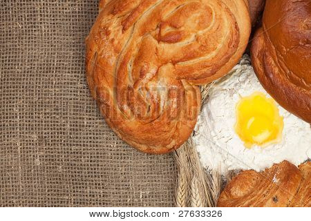Bread With Ears Of Rye And Flour Background