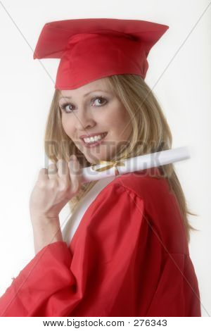 Woman In Cap And Gown Holding Diploma