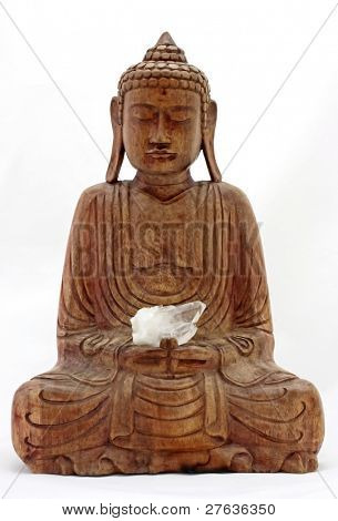 Buddha meditating from wood