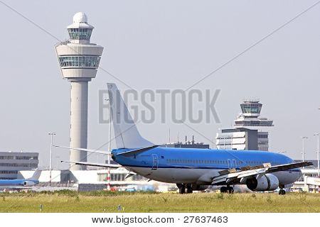 Schiphol airport with airplane landing in the Netherlands