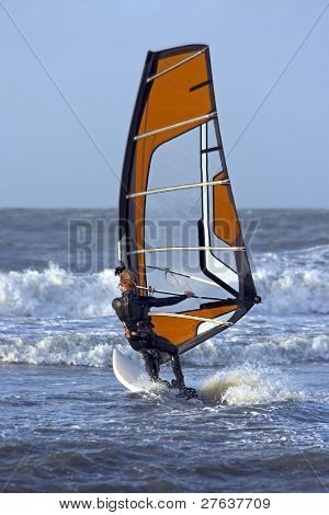 Windsurfer surfing the north sea in the Netherlands
