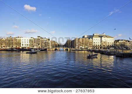 The river Amstel with theater Carre in Amsterdam the Netherlands