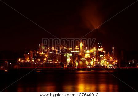 Petroleum refinery in Amsterdam harbor at night in the Netherlands