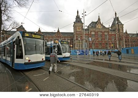 Trams waiting in front of the central station in Amsterdam the Netherlands