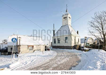 Medieval church from wood in the snowy countryside from the Netherlands