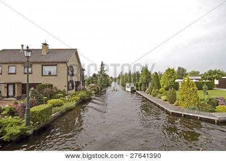 Typical dutch landscape: Houses along the waterline in the Netherlands