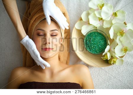 poster of Skin And Body Care. Close-up Of A Young Woman Getting Spa Treatment At Beauty Salon. Spa Face Massag