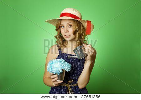 Attractive girl watering flowers