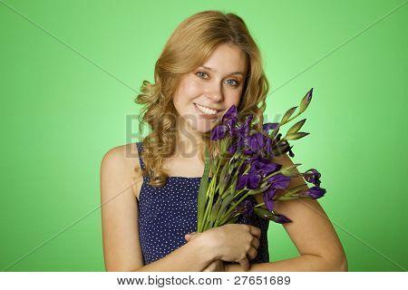Attractive girl hugging a bouquet of iris