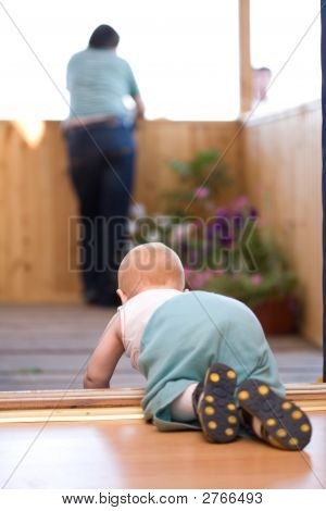Little Baby Crawling To His Father Staying On Terrace