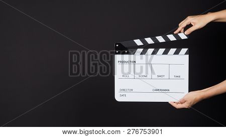 Two Hands Holding White Clapperboard