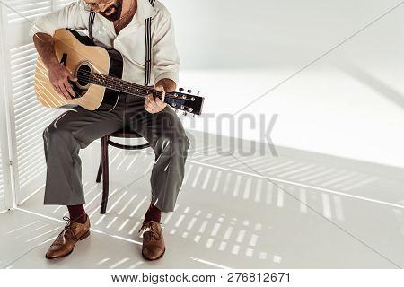 Bearded Man In Glasses Sitting