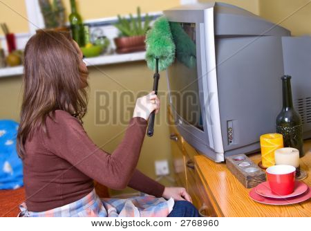 Woman Is Dusting On Shelf