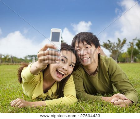 asian couple taking photo by smart mobile phone