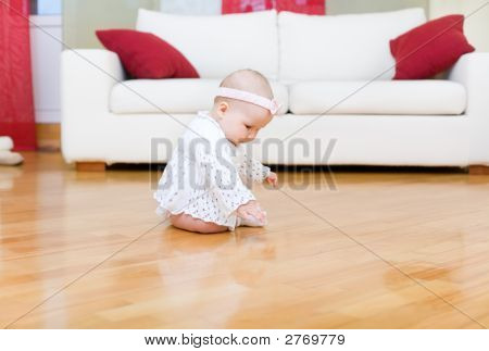 Happy Baby Girl Touch A Hardwood Floor