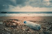 Trash, Plastic, Garbage, Bottle... Environmental Pollution On The Beach. Royalty High-quality Free S poster