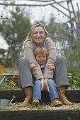 picture of mother child  - a mother and her young son in a flower filled garden - JPG