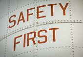 foto of first aid  - A Metal work sign painted with the words SAFETY FIRST - JPG