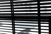Opened Venetian Plastic Blinds In Black And White. Plastic Window With Blinds. Interior Design Of Li poster