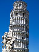 Leaning Tower Of Pisa With Putti Fountain Sculpture In The Foreground In Piazza Dei Miracoli Or Squa poster