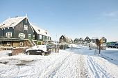 Traditional village Marken with wooden houses in winter in the Netherlands