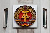 stock photo of communist symbol  - This symbol of the German communist party is displayed near the Checkpoint Charlie at the Berlin Wall - JPG