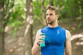 Just A Minute To Rest. Man Athletic Appearance Holds Bottle With Water. Man Athlete In Sport Clothes poster