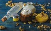 Homemade Spa With Natural Ingredients Of Calendula And Beeswax, Homemade Spa On A Wooden Background poster