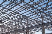 Metal Beams At The Top Of The Unfinished Steel Structure Of The Building Under Construction, Against poster