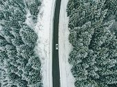 White Suv Overhead View Road Trip Frozen Highway In Snowed Winter Time. poster