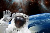 Astronaut In Outer Space In Spacesuit Against The Background Of The Earths Blue Orbit And Space With poster