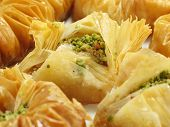 foto of phyllo dough  - A sweet pastry made of layered phyllo dough honey and chopped pistachios and walnuts - JPG