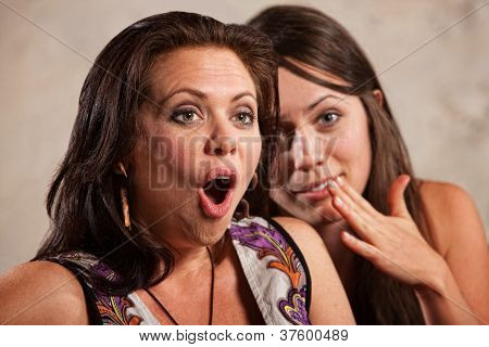 Shocked Woman And Whispering Friend