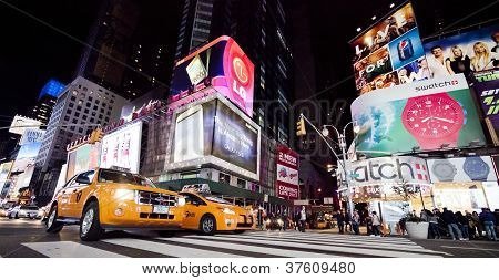 New York City - Sept 26: Times Square, Featured With Broadway Theaters, Taxi Cabs And Animated Led S