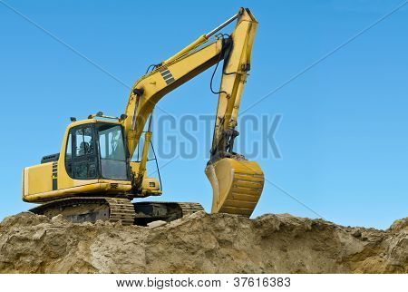 Yellow Excavator On Sand Hill