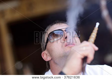 Man Smoking Hookah