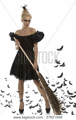 Sexy Girl In Halloween Suit With Besom In All Hands