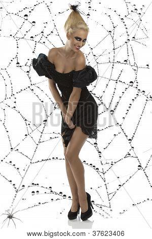 Sexy Girl In Halloween Suit With Hands Between The Legs