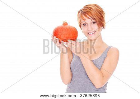 holding a pumpkin for halloween