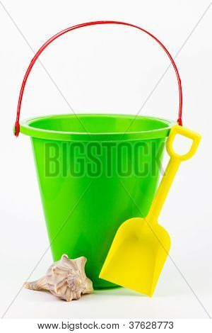 A Sand Bucket, Shovel, And Seashell.