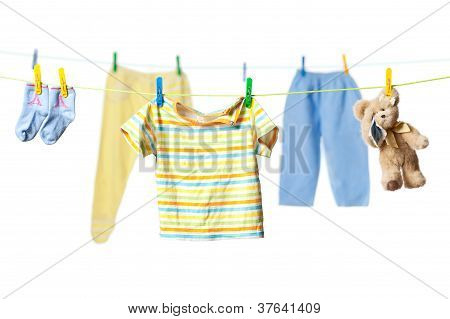 Drying Baby Clothes And A Teddy Bear