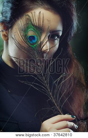 Beauty With A Peacock Feather