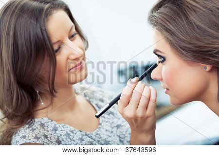 Make-up Artist Applying Kohl