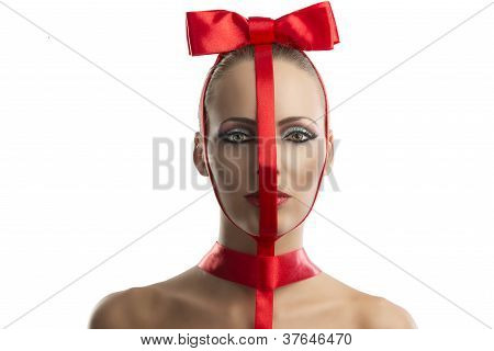 Beauty Portrait Of Girl With Red Bow, She Is In Front Of The Camera