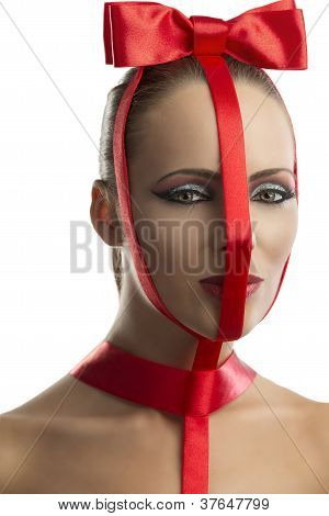 Beauty Portrait Of Girl With Red Bow Looks In To The Lens